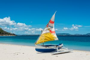 Ifaty beach 300x200 - Malagasy outrigger pirogue with colorful makeshift sails on the white beach